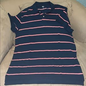 Blue polo shirt with pink stripes